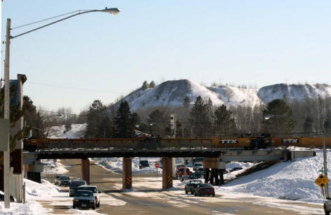 Railroad overpass on Gary Street in Marble Minnesota with mine tailing mounds in background, 2007