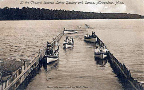 Boats in the channel between Lakes Darling and Carlos, near Alexandria, 1910