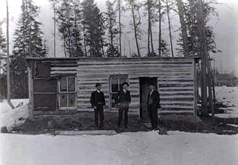 Edward McCann and others standing in front of parsonage at Big Falls, 1909