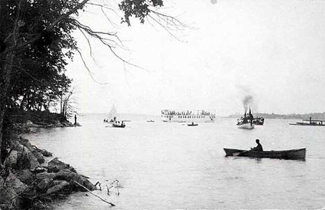 Boats and steamer on Cass Lake, Cass County, 1910