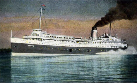 Steamer Hamonic leaving Duluth Superior Harbor at dusk, 1931