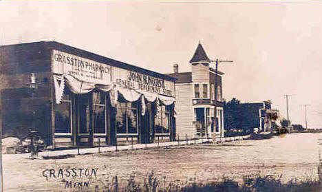 View of Grasston Minnesota showing Grasston Pharmacy, and John Runquist General Department Store, 1910