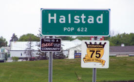 Halstad Minnesota population sign on US Highway 75