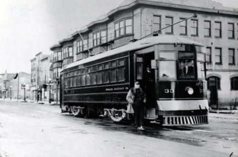 The Mesaba Railway ran streetcar service between Hibbing and North Hibbing. This car is posed at the north end of the line in front of the Oliver Hotel on 3rd Avenue in North Hibbing. 1921