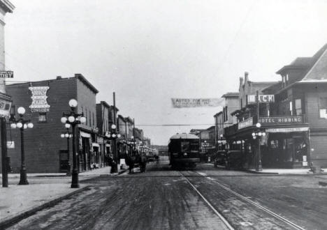 Mesaba Ry. Interurban train on 3rd Ave. in old Hibbing, later named North Hibbing when the town was moved for iron ore mining. 1915.