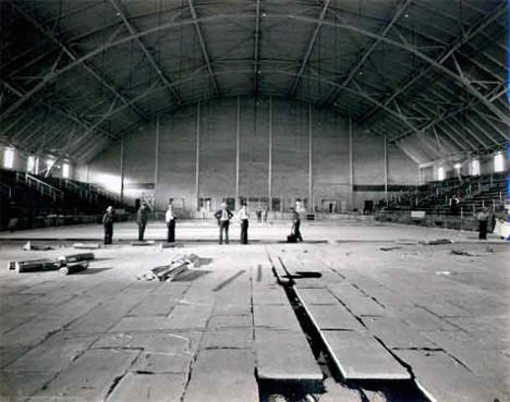 Laying of floor materials during construction of Hibbing Memorial Building, 1935