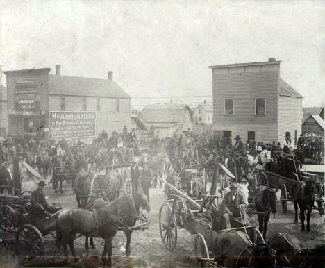 Farmers picking up McCormick farm implements at M. O. Bakko Store, Kenyon Minnesota, 1901
