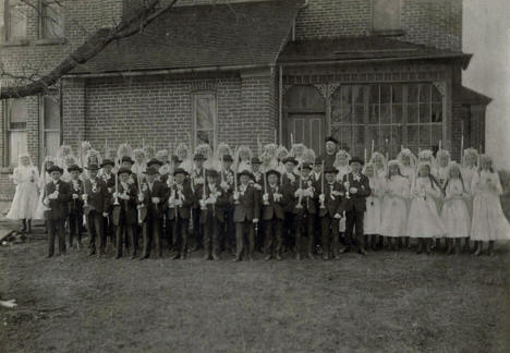 First Communion Class with Rev. Martin Schmidt, OSB in Meire Grove, MN in Church of St. John the Baptist, 1922