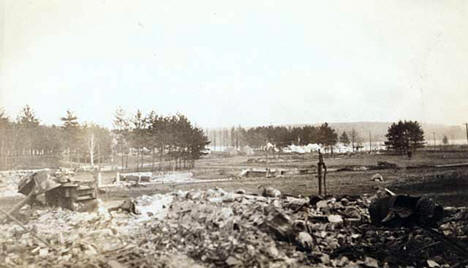 Ruins of Moose Lake following the fire; Minnesota Home Guard camp in the distance, Moose Lake Minnesota, 1918