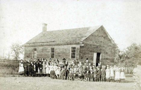 Teachers and pupils at the first school built by Father Francis Pierz, 1872
