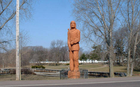 Pine City's 35 foot redwood voyageur statue in Riverside Park