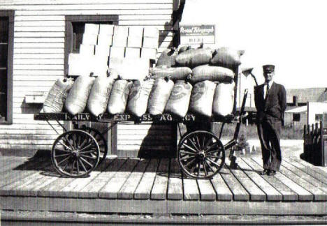 Depot Agent Ed Trombly with shipment of Hicks Wild Rice at Depot, Remer Minnesota, late 1920's or early 1930's