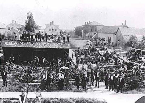 Farm machinery dealers displaying their wares, Rush City Minnesota, 1892