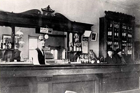 Visitors and bartender inside the Harris Saloon, Tenstrike Minnesota, 1905