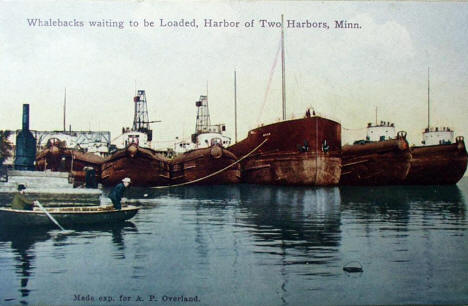 Whalebacks waiting to be loaded, Two Harbors Minnesota, 1910's