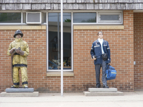 Fireman and Paramedic statues in front of City Hall, Truman Minnesota, 2014