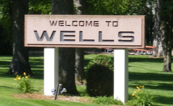 Welcome sign, Wells Minnesota