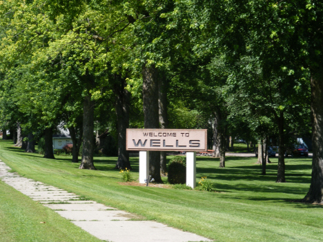 Welcome sign, Wells Minnesota, 2014