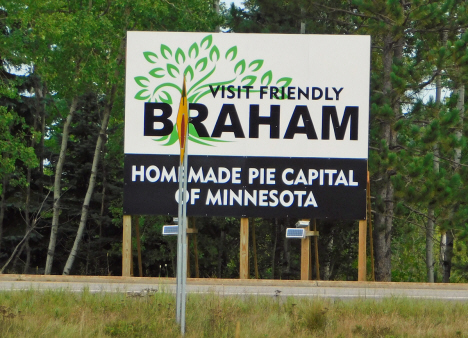 Visit Friendly Braham sign at junction of State Highways 65 and 107 near Braham Minnesota, 2018