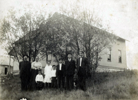 Alex Esko and family by their farm house on the banks of the Midway River, Esko Minnesota, 1910