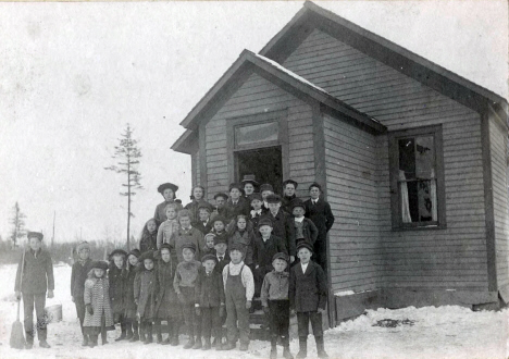 Esko one-room schoolhouse, with teacher and students, Esko Minnesota, 1907