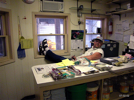 Unidentified man at the main office in the feed mill in Grasston Minnesota, 2002