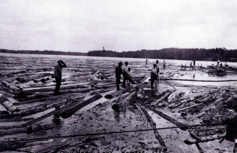 Running logs on Bullhead Lake, Kelliher Minnesota, 1907