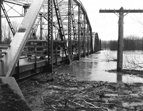 Flooding of the Minnesota River as seen from the old iron truss bridge outside Belle Plaine, Minnesota on April 11, 1951