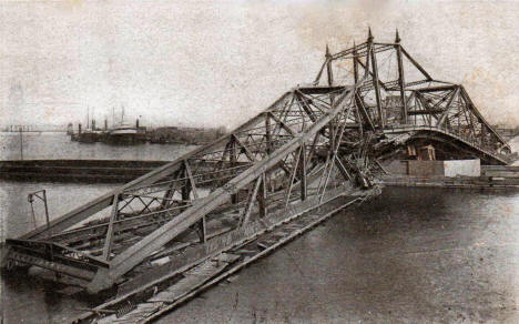 Draw span of the Interstate Bridge between Duluth and Superior, wrecked by the steamer Troy of the Western Transit Line, August 11, 1906